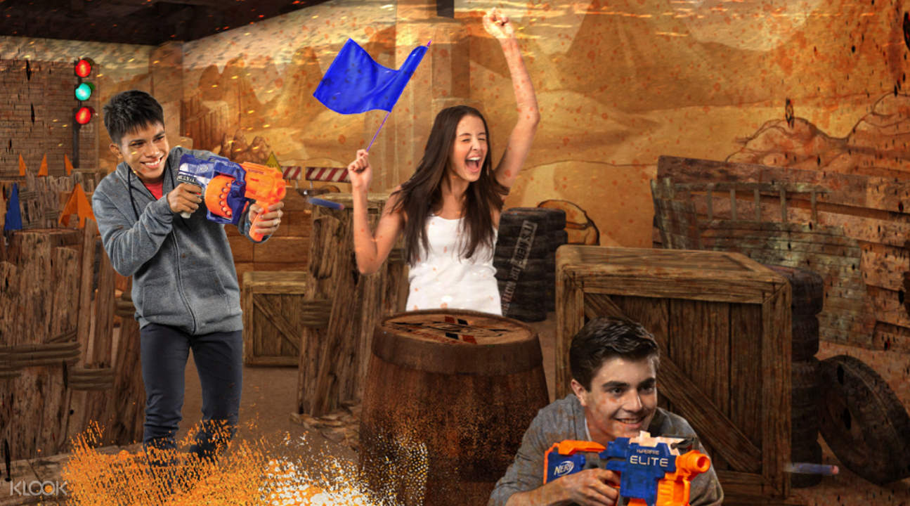 people with NERF guns inside NERF Action Xperience Singapore